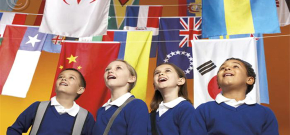 School Children Looking Up at Flags of the World